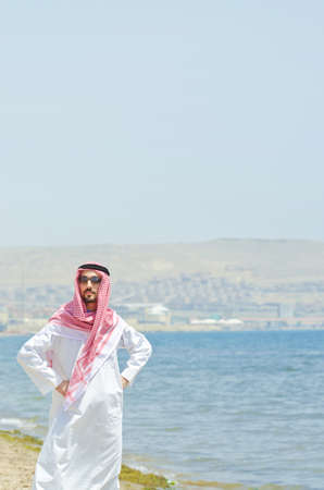 Arab on seaside in traditional clothing Stock Photo - 14703683