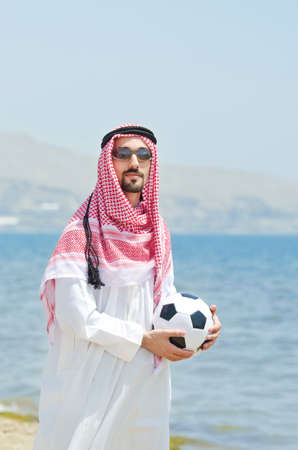 Arab with footbal at seaside Stock Photo - 14703709