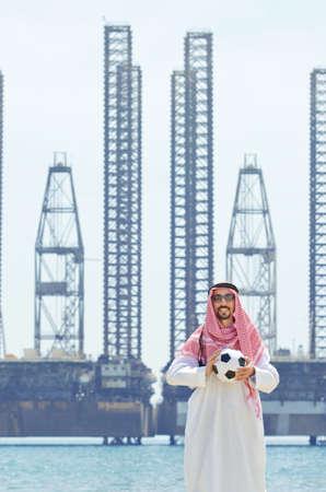 Arab with footbal at seaside Stock Photo - 14703701