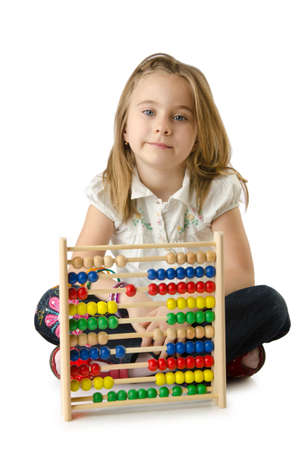 Girl with abacus on white Stock Photo - 14703646
