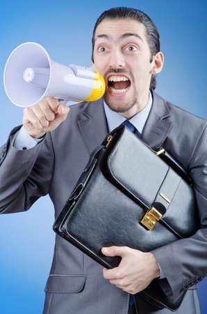 Businessman shouting via loudspeaker Stock Photo - 14703811