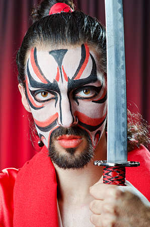 Man with face mask and sword Stock Photo - 14703826