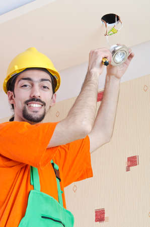 Electrician working on cabling lighting Stock Photo - 14725903