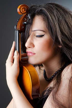 violin player: Female violin player against background