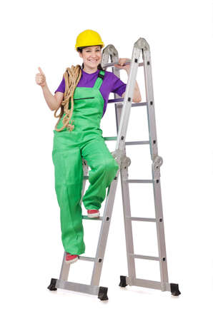 Woman worker standing on ladder Stock Photo - 14703624