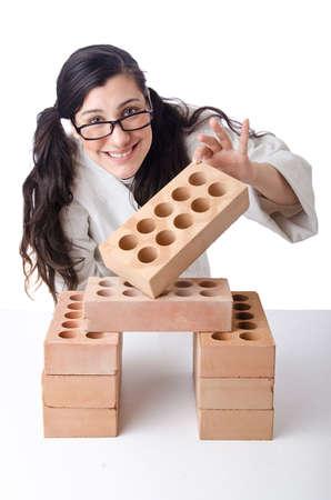 Woman karate breaking bricks on white Stock Photo - 14703734