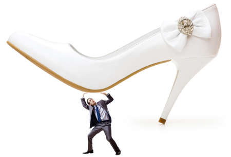 Woman domination concept with shoes and man Stock Photo - 14703529
