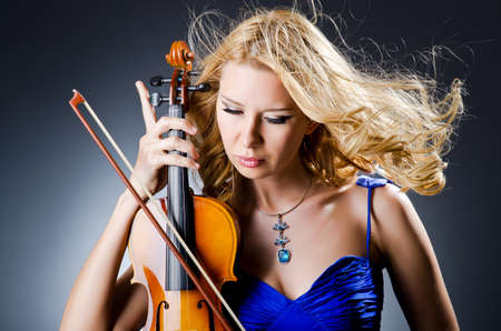 Woman with violin in studio photo