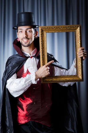Magician with photoframe in studio Stock Photo - 14919179