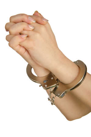Handcuffed hands on white background photo
