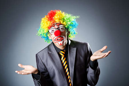 Businessman with clown wig and face paint photo
