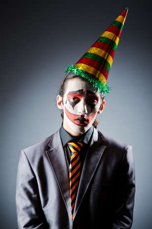 Businessman with clown wig and face paint Stock Photo - 14919181