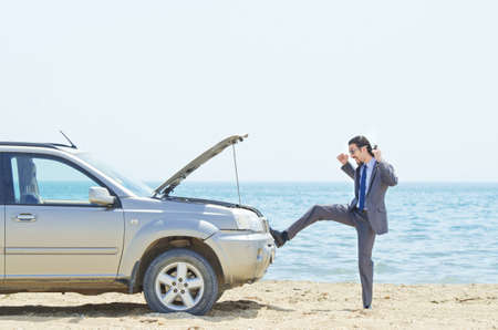 Man with car on seaside Stock Photo - 14725303