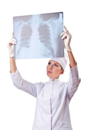 Woman doctor examining x-ray on white Stock Photo - 14907887
