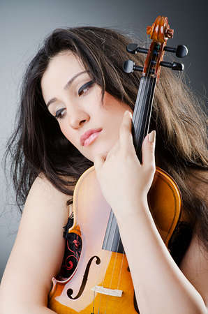 Female violin player against background Stock Photo - 14908338