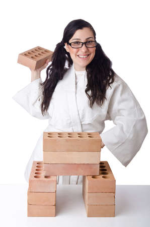 Woman karate breaking bricks on white Stock Photo - 14725413