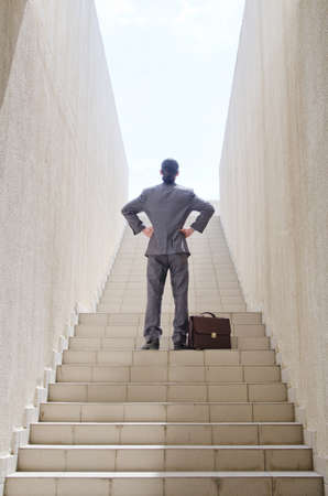 Businessman with stair in business concept photo