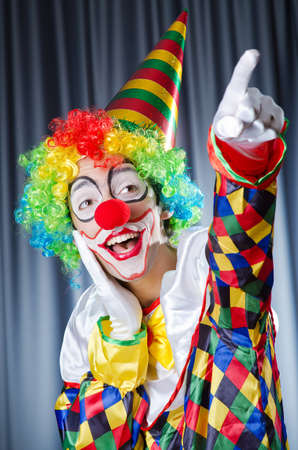 Funny clown in studio shooting photo