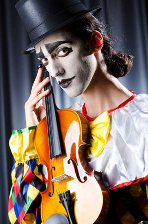 entertainment: Clown playing on the violin