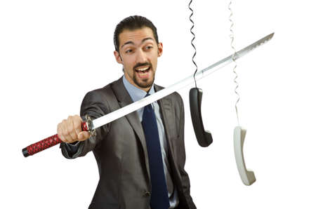 Angry businessman cutting the phone cable photo