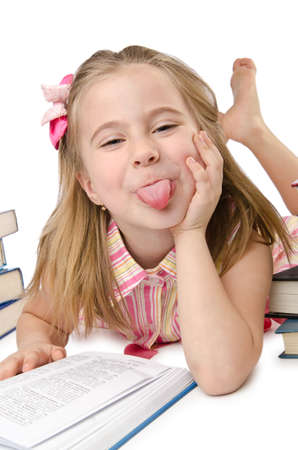 Little girl with books on white photo