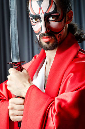 Man with face mask and sword Stock Photo - 14769833