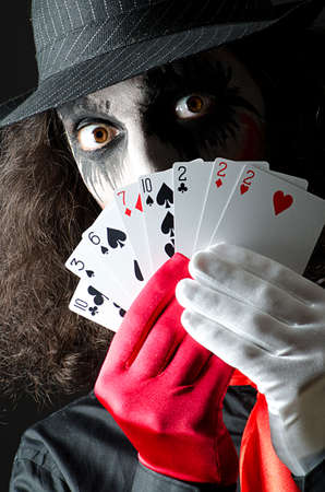Joker with cards in studio shoot photo