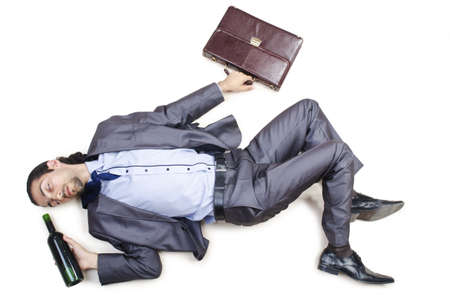 Drunk businessman on the floor photo