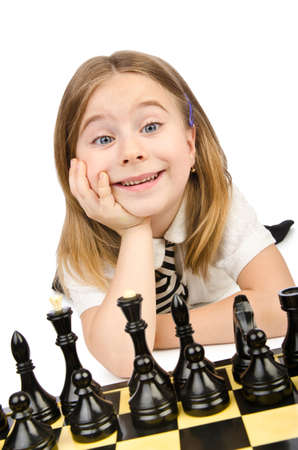 Cute girl playing chess on white photo
