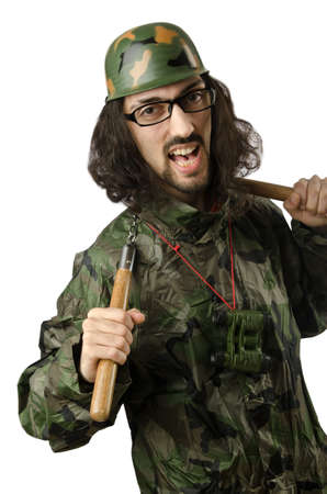 Funny soldier with nunchaku photo