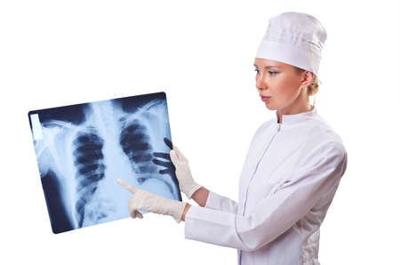 Woman doctor examining x-ray on white Stock Photo - 14772378