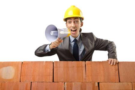 Businessman with bricks on white photo