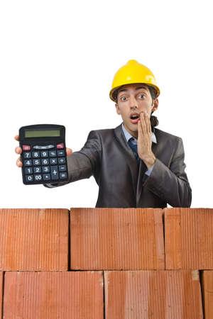 Businessman with bricks on white Stock Photo - 14814472