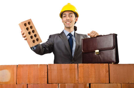 Businessman near brick wall photo