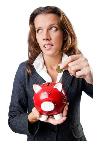 Woman with piggybank on white photo