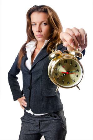 Businesswoman with alarm clock on white photo