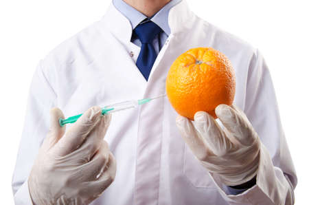 Science experiment with orange and syringe photo