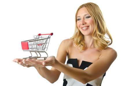 Attractive woman with shopping cart photo