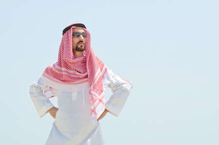 Arab on seaside in traditional clothing Stock Photo - 14909183