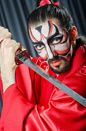 Man with face mask and sword Stock Photo - 14910238