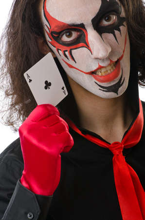 Joker with cards isolated on white photo