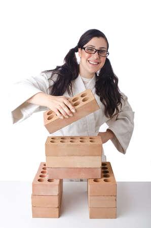 Woman karate breaking bricks on white Stock Photo - 14909261
