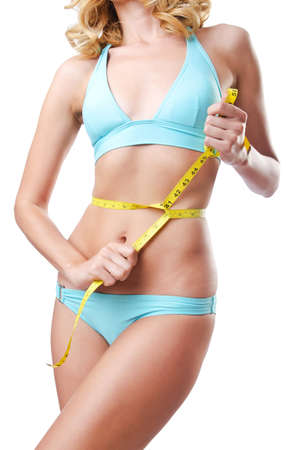 Young lady with centimetr in weight loss concept Stock Photo - 14983663