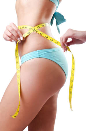 Young lady with centimetr in weight loss concept Stock Photo - 14983630