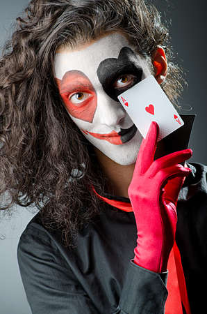 Joker with face mask in studio photo