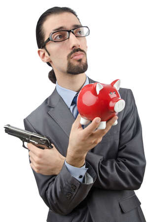 Businessman killing the piggy bank photo