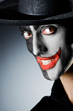 Businessman with clown face paint photo