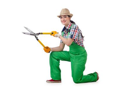 Girl with garden scissors on white photo