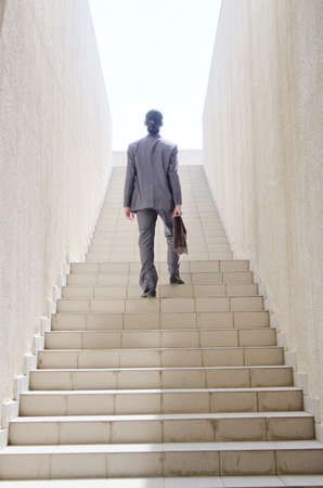 corporate ladder: Businessman with stair in business concept