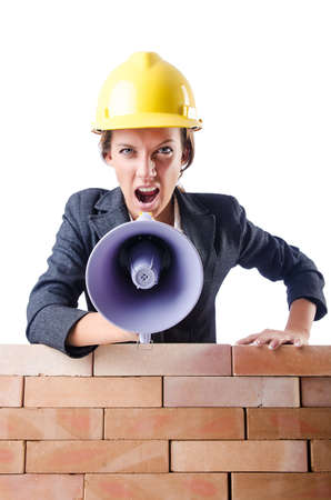 Woman builder with loudspeaker on white photo
